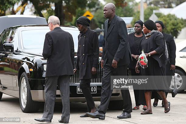 Joseph Tito Manyang and his wife Akon Guode at the funeral of their 3 children Bol Anger and Madit who were tragically killed when Akon Goude veered...