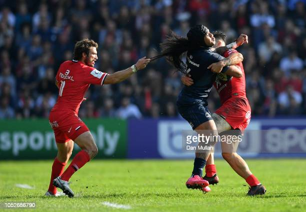 Joseph Tomane of Leinster is tackled by Maxime Medard and Sofiane Guitoune of Toulouse during the Champions Cup match between Toulouse and Leinster...
