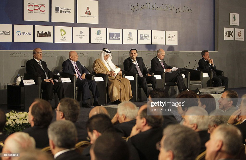 Joseph Torbey, president of the Association of Banks in Lebanon, Rauf Abu Zaki, general manager of Al-Iktissad Wal-Aamal Group, Saudi Prince Khaled al-Faisal bin Abdul Aziz al-Saud, governor of Mecca, Lebanese Prime Minister Saad Hariri, his Greek counterpart George Papandreou and Riad Salameh, governor of the Central Bank of Lebanon, attend the opening session of the Arab Economic Forum in the Lebanese capital Beirut on May 20, 2010.