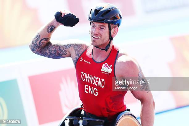Joseph Townsend of England celebrates before the finish line after winning the gold medal in the Men's PWTC Triathlon on day three of the Gold Coast...