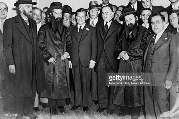 Joseph V McKee at Seward Park High School posing with several rabbis who listened to his campaign speech