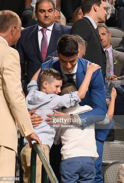 Joseph Veleno reacts after being selected thirtieth overall by the Detroit Red Wings during the first round of the 2018 NHL Draft at American...