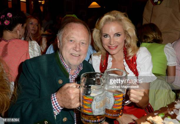 Joseph Vilsmaier and Birgit Muth attend the Oktoberfest beer festival at Theresienwiese on September 21 2013 in Munich Germany