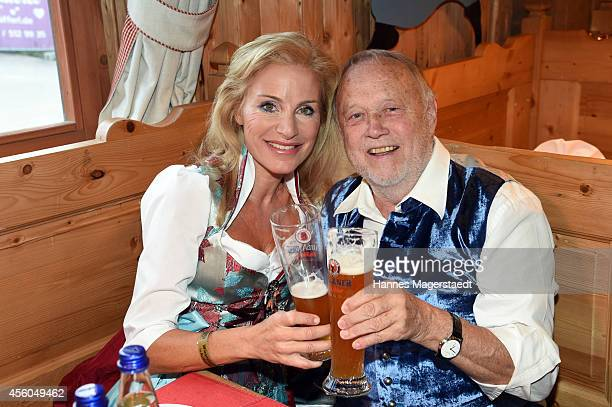 Joseph Vilsmaier and Birgit Muth attend the Radio Gong 963 Wiesn at Weinzelt during Oktoberfest at Theresienwiese on September 24 2014 in Munich...