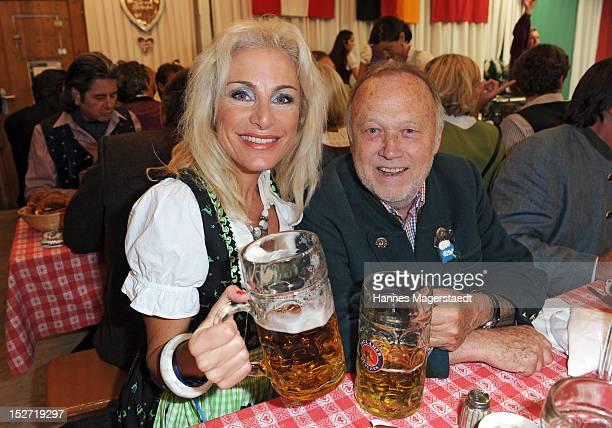 Joseph Vilsmaier and girlfriend Birgit Muth attend the 'BMW Wiesn' as part of the Oktoberfest beer festival at the Armbrustschuetzen beer tent on...