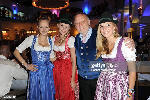 Joseph Vilsmaier and his daughters Theresa Janina and Josefina attend the Angermaier Kicks Off Oktoberfest Season With 'TrachtenNacht' on September 1...