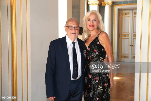 Joseph Vilsmaier and his girlfriend Birgit Muth during the 'Oper fuer alle Parsifal' as part of the Munich Opera Festival at Nationaltheater on July...