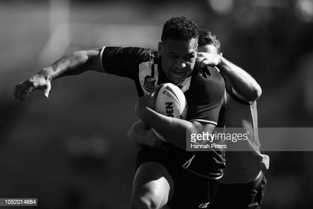 This image has been converted to black and white Joseph Vuna of the Junior Kiwis charges forward during the international Rugby League Test Match...