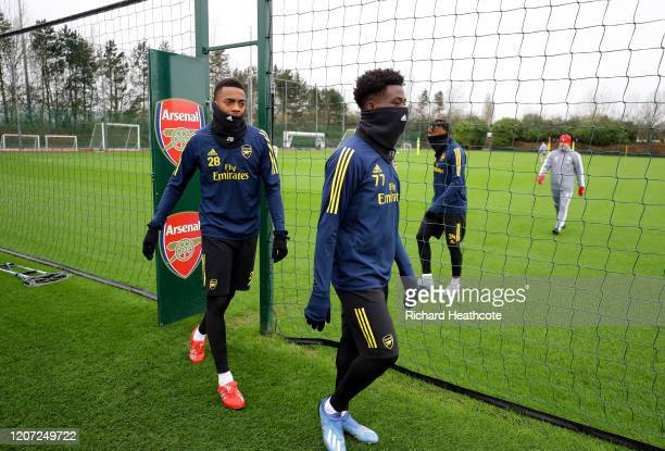 Joseph Willock and Bakayo Saka of Arsenal walk to the ground during a Arsenal Training Session at London Colney on February 19 2020 in St Albans...
