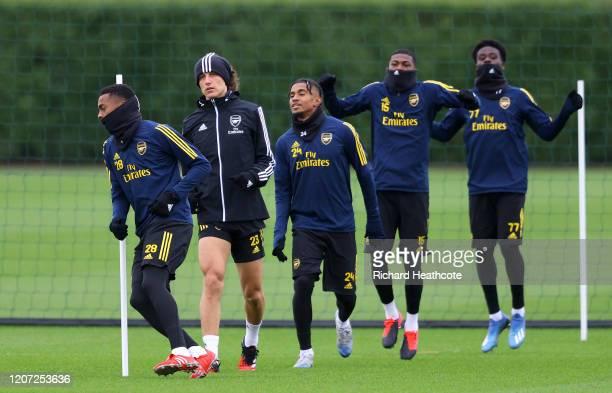 Joseph Willock David Luiz Reiss Nelson Ainsley MaitlandNiles and Bukayo Saka of Arsenal warm up during a Arsenal Training Session at London Colney on...