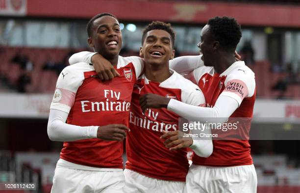 Joseph Willock of Arsenal celebrates after scoring his team's first goal with Tyreece JohnJules of Arsenal and James Olayinka of Arsenal during the...