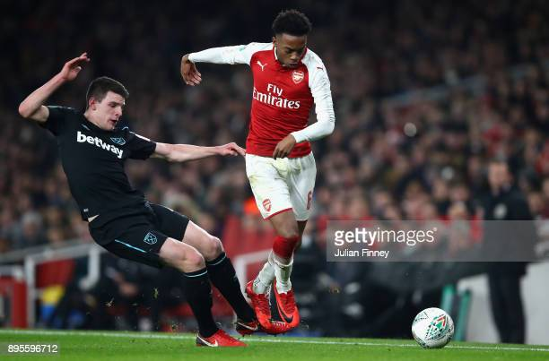 Joseph Willock of Arsenal evades Declan Rice of West Ham United during the Carabao Cup QuarterFinal match between Arsenal and West Ham United at...