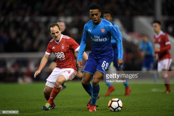 Joseph Willock of Arsenal is closed down by David Vaughan of Nottingham Forest during The Emirates FA Cup Third Round match between Nottingham Forest...