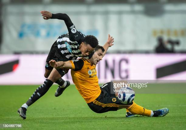 Joseph Willock of Newcastle United and Jonny of Wolverhampton Wanderers in action during the Premier League match between Newcastle United and...