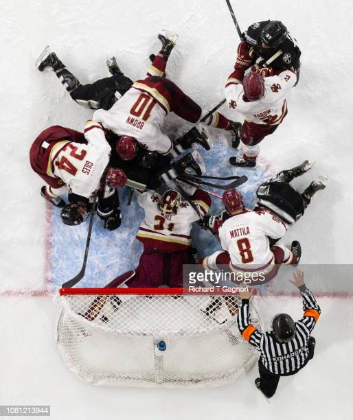 Joseph Woll of the Boston College Eagles makes a save against the Providence College Friars as his teammates Patrick Giles Michael Karow Christopher...