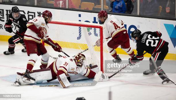 Joseph Woll of the Boston College Eagles makes a save against the Northeastern Huskies during NCAA hockey in the championship game of the annual...