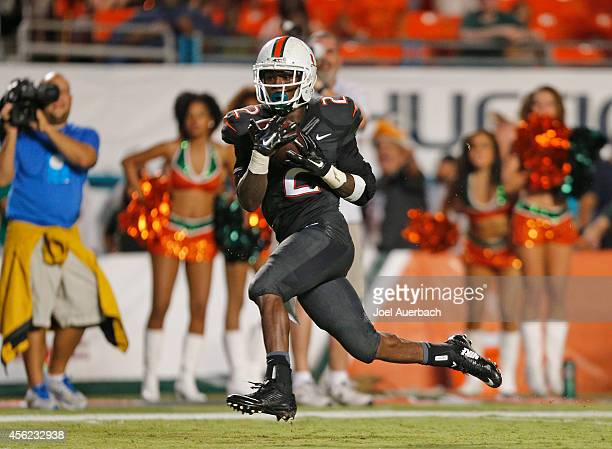 Joseph Yearby of the Miami Hurricanes catches the ball and runs for a touchdown against the Duke Blue Devils in the fourth quarter on September 27...