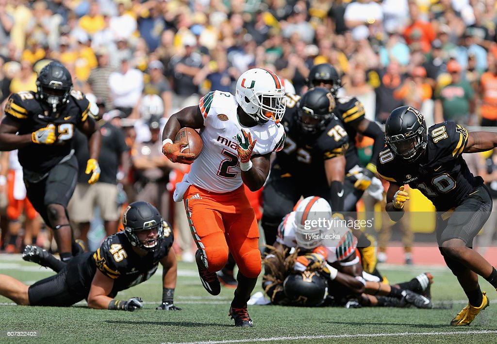Joseph Yearby #2 of the Miami Hurricanes runs with the ball against the Appalachian State Mountaineers during their game at Kidd Brewer Stadium on September 17, 2016 in Boone, North Carolina.