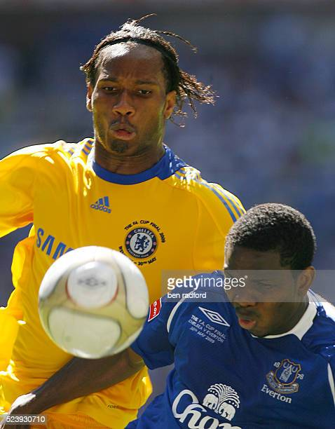 Joseph Yobo of Everton and Didier Drogba of Chelsea during the FA Cup Final between Everton and Chelsea at Wembley Stadium in London UK