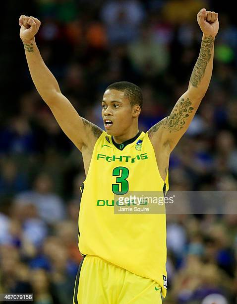 Joseph Young of the Oregon Ducks celebrates in the second half against the Oklahoma State Cowboys during the second round of the 2015 NCAA Men's...