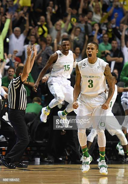 Joseph Young of the Oregon Ducks reacts in front of his bench after he hit a game-winning 3-pointer in a semifinal game of the Pac-12 Basketball...
