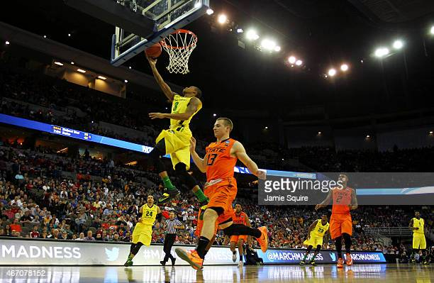 Joseph Young of the Oregon Ducks shoots over Phil Forte III of the Oklahoma State Cowboys in the second half during the second round of the 2015 NCAA...