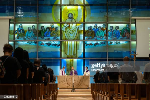 Joseph Zen, cardinal of the Holy Roman Church, center, attends a church service at St. Andrew's Parish in Hong Kong, China, on Friday, June 4, 2021....