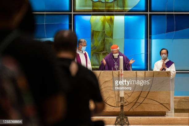 Joseph Zen, cardinal of the Holy Roman Church, center, speaks during a church service at St. Andrew's Parish in Hong Kong, China, on Friday, June 4,...