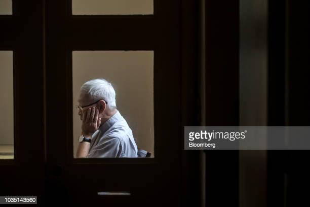 Joseph Zen, cardinal of the Holy Roman Church, is seen through a window during an interview in Hong Kong, China, on Saturday, Aug. 18, 2018. Zen--...