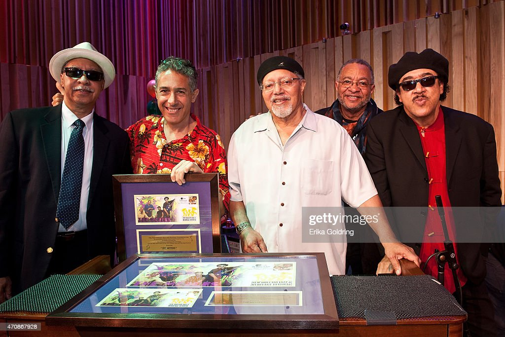 Joseph 'Zigaboo' Modeliste, photographer John Nunu Zomot, Art Neville, George Porter Jr., and Leo Nocentelli of the original The Meters gather for a photo during the Jazz Fest Postal Cachet unveiling at George and Joyce Wein Jazz & Heritage Center on April 23, 2015 in New Orleans, Louisiana.