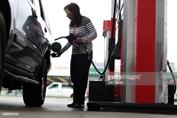 Josephina Romano fills her vehicle with gas at a UGas station on October 19 2015 in Miami Florida As gas prices remain low across the nation a recent...