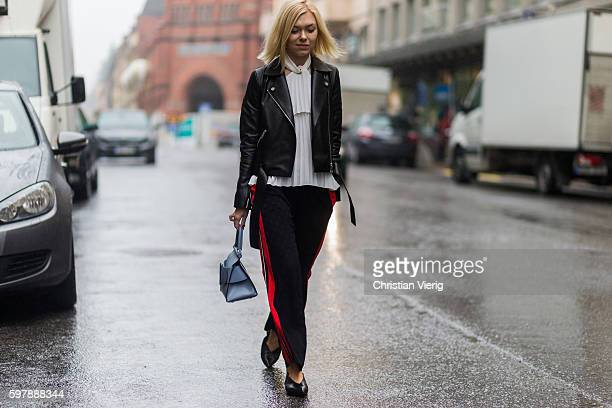 Josephine Aarkrogh wearing a black leather jacket from Aeron a blue Boyy bag white blouse from Birgitte Herskindand track suit jogger pants from...