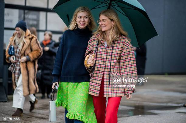 Josephine Aarkrogh wearing a knit green skirt and Mie Juel wearing checked blazer red pants outside Cecilie Bahnsen during the Copenhagen Fashion...