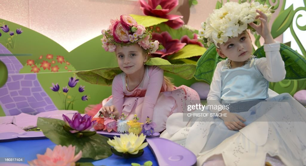 Josephine and Maja play with new flower fairy dolls at a booth during the press preview of the international toy fair in Nuremberg, southern Germany, on January 29, 2013. Around 2.700 exhibitors show more than 1 million products at the international toy fair which opens its doors from January 29 to February 4, 2013.