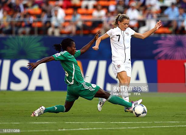Josephine Chukwunonye of Nigeria and Kealia Ohai of USA battle for the ball during the FIFA U20 Women's World Cup Japan 2012 Semi Final match between...