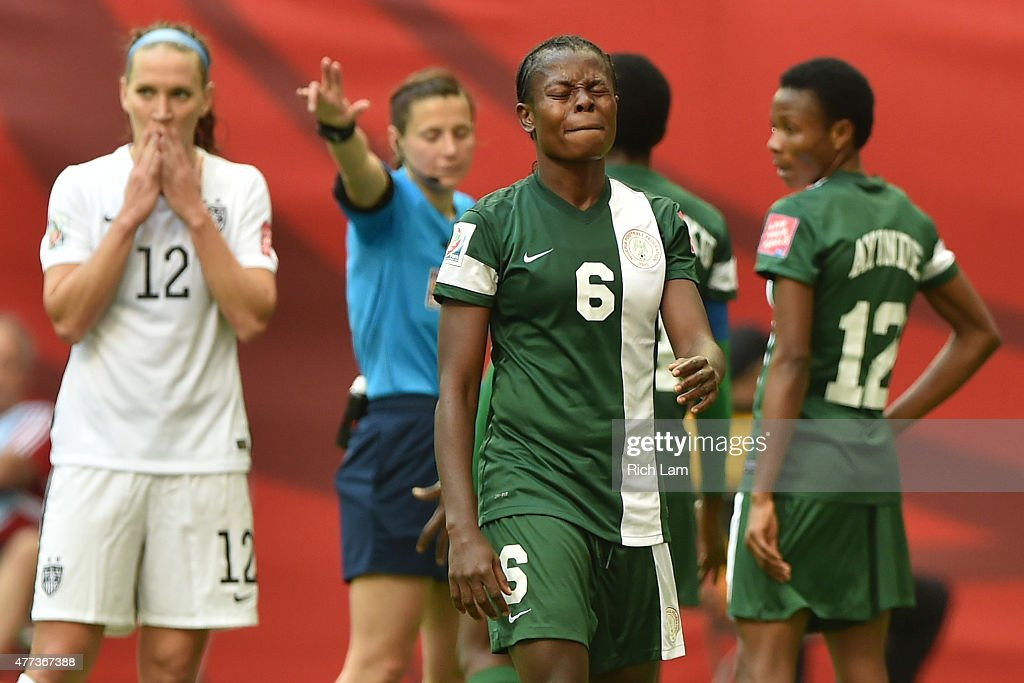 Josephine Chukwunonye #6 of Nigeria reacts after teammate Sarah Nnodim #22 of Nigeria is given a red card in the second half against the the United States in the Group D match of the FIFA Women's World Cup Canada 2015 at BC Place Stadium on June 16, 2015 in Vancouver, Canada.