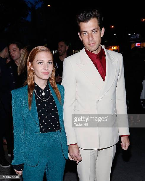 Josephine de la Baume and Mark Ronson attend the Voguecom Met Gala Cocktail Party at Search Destroy on April 30 2016 in New York New York