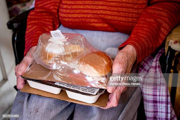 Josephine Hayward of Portland holds a meal of ham with a raisin sauce sweet potatoes a broccoli casserole bread and apple pie for dessert that was...