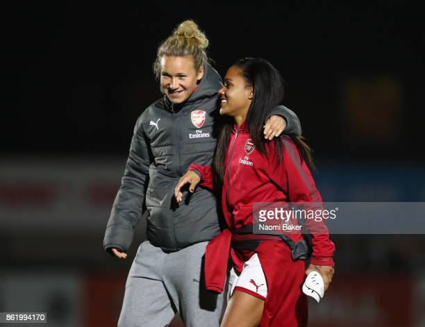 Josephine Henning and Alex Scott congratulate each other after their side win during the FA Women's Super League Continental Cup match between...