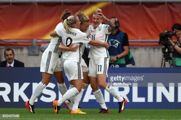 Josephine Henning is celebrated after scoring the opening goal during the UEFA Women's Euro 2017 Group B match between Germany and Italy at Koning...