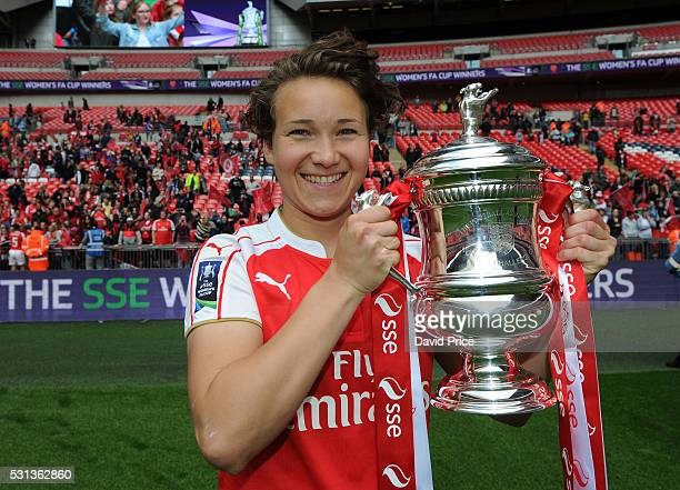Josephine Henning of Arsenal Ladies lifts the FA Cup Trophy the match between Arsenal Ladies and Chelsea Ladies at Wembley Stadium on May 14 2016 in...
