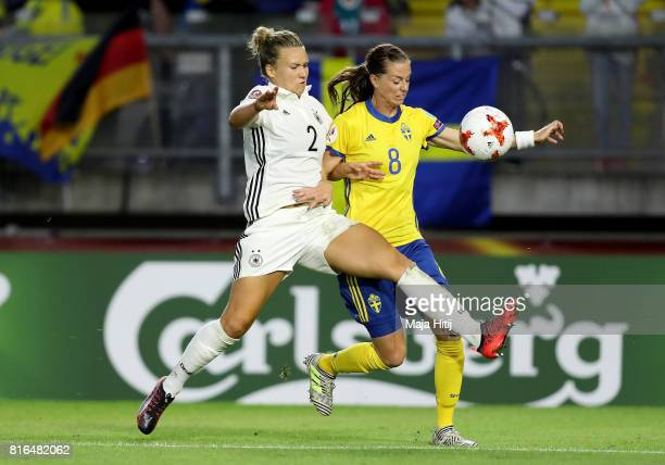 Josephine Henning of Germany and Lotta Schelin of Sweden compete for the ball during the Group B match between Germany and Sweden during the UEFA...