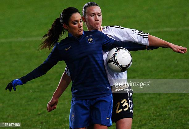 Josephine Henning of Germany and Louisa Necib of France compete for the ball during the Women's International Friendly match between Germany and...