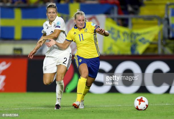 Josephine Henning of Germany and Stina Blackstenius of Sweden compete for the ball during the Group B match between Germany and Sweden during the...