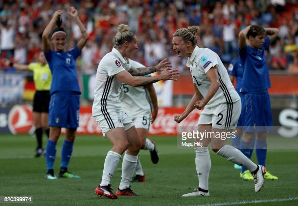 Josephine Henning of Germany celebrate with team mate Anja Mittag after she heads the opening goal during the Group B match between Germany and Italy...