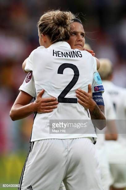 Josephine Henning of Germany celebrate with team mate Dzsenifer Marozsán after she heads the opening goal during the Group B match between Germany...