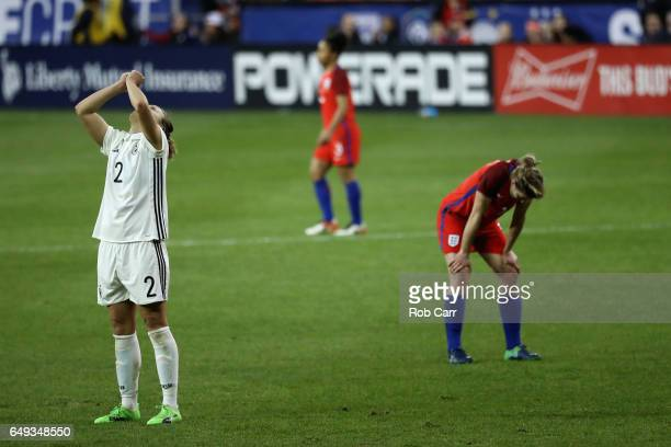 Josephine Henning of Germany celebrates in front of Ellen White of England following Germany's 10 win during the 2017 SheBelieves Cup at RFK Stadium...