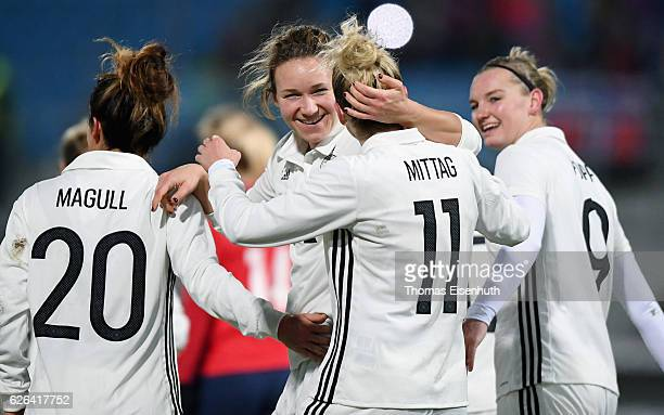 Josephine Henning of Germany celebrates with Anja Mittag during the women's international friendly match between Germany and Norway at community4you...