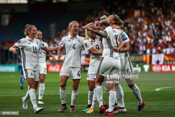 Josephine Henning of Germany celebrates with the team after scoring her sides first goal during the UEFA Women's Euro 2017 at Koning Willem II...