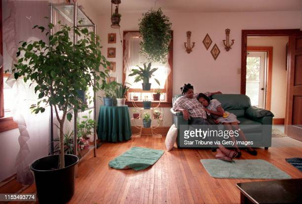 Josephine Hill and her 8yearold daughter Dorothy share a moment in their home in North Minneapolis Hill who has 9 children expresses concern about...